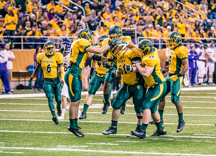 North Dakota State Bison Brian Schaetz is mobbed by teammates Nate Tanguay, MJ Stumpf, Greg Menard, Jordan Champion and CJ Smith after a big play.