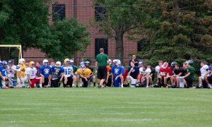 Players get ready for a practice at the Bison football summer camp